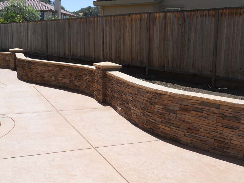 We Paired It Up With A Waist High Curved Rock Wall. We Also Built In A  Landscape Area Along The Fence To Include Green Accents. This Build Would  Not Be ...